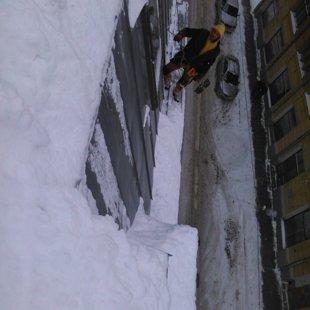 sniega tīrīšana no jumta